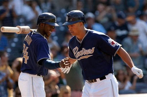San Diego Padres' Will Venable, right, is congratulated by teammate Orlando Hudson, left, while returning to the dugout after hitting a leadoff home run in the first inning of a baseball game against the San Francisco Giants at Petco Park.