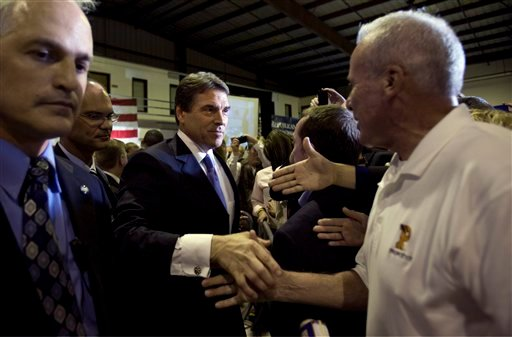 Republican presidential candidate Texas Gov. Rick Perry greets members of the crowd during a rally Wednesday, Sept. 7, 2011, in San Diego.