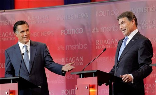 Republican presidential candidates former Massachusetts Gov. Mitt Romney, left, and Texas Gov. Rick Perry answer a question during a Republican presidential candidate debate at the Reagan Library Wednesday, Sept. 7, 2011, in Simi Valley, Calif.