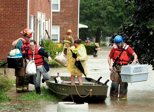 Home owners are rescued by boat by Paxtang firemen as the remains of Tropical Storm Lee cause flooding on Brisbane Street in Harrisburg, Pa., Wednesday, Sept. 7, 2011.