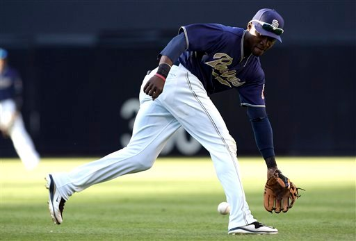 San Diego Padres' Orlando Hudson makes a play on the ball during the fifth inning of a baseball game against the San Francisco Giants at Petco Park on Wednesday, Sept. 7, 2011, in San Diego.
