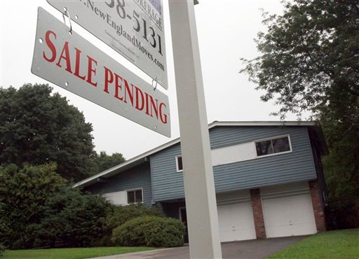 A sign announces a pending residential home sale in Wayland, Mass., Wednesday, Aug. 10, 2011.