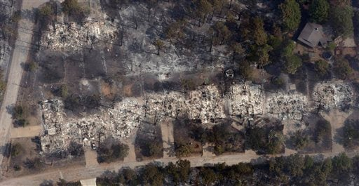 This aerial image shows a row of homes destroyed by a wildfire, Wednesday, Sept. 7, 2011, in Bastrop, Texas.
