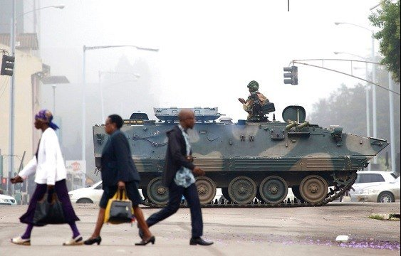 An armed soldier patrols a street in Harare, Zimbabwe, Wednesday, Nov. 15, 2017.