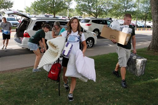 In this photo taken Thursday, Aug. 18, 2011, students move in for the fall semester at Colorado State University in Fort Collins, Colo.