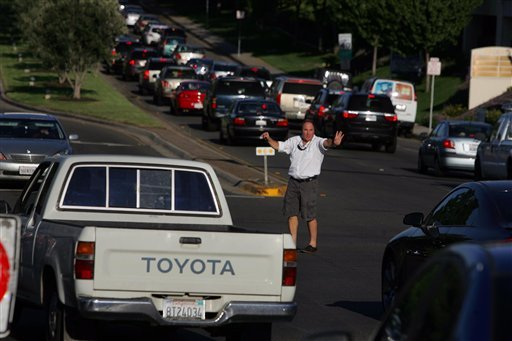 Good Samaritan Dave Eminhizer directs traffic at the intersection of Rancho Bernardo Road and Bernardo Center Drive during a power outage on Thursday Sept. 8, 2011, in San Diego.