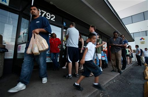 Hugo Camacho, left, and his son Daniel Camacho, 5, emerge from a 7-11 with Gatorade and Cheetos late Thursday, Sept. 8, 2011, in San Diego.