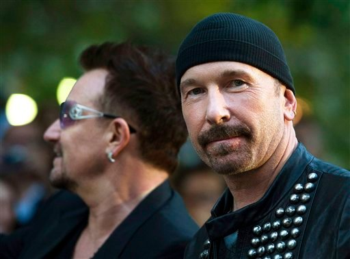 """Bono, left, and The Edge, of the Irish band U2, arrive for the gala screening of the U2 documentary """"From the Sky Down"""" at the Toronto International Film Festival on Thursday Sept. 8, 2011. (AP Photo/The Canadian Press, Nathan Denette)"""