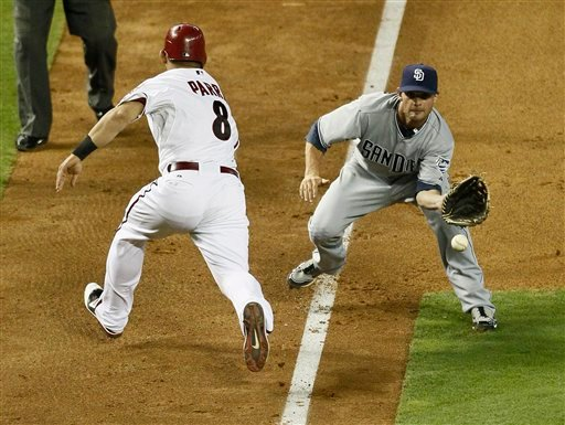 San Diego Padres' Andy Parrino makes to catch to tag out Arizona Diamondbacks' Gerardo Parra (8) after Parra was caught in a run down during the seventh inning of a baseball game, Thursday, Sept. 8, 2011, in Phoenix. (AP Photo/Matt York)