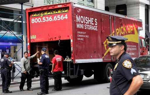 New York City police officers stop a commercial truck at an checkpoint in New York's financial district, Friday, Sept. 9, 2011. U.S. officials said Thursday that they were chasing a credible but unconfirmed al-Qaida threat.