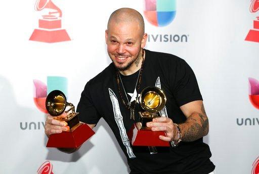 "Residente poses in the press room with the award for best urban music album for ""Residente"" and best urban song for ""Somos Anormales"" at the 18th annual Latin Grammy Awards at the MGM Grand Garden Arena on Thursday, Nov. 16, 2017, in Las Vegas. (Photo by"