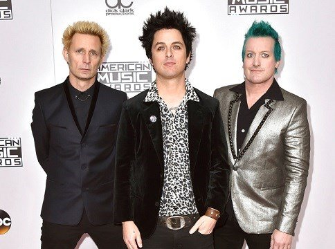 Mike Dirnt, from left, Billie Joe Armstrong, and Tre Cool, of Green Day, arrive at the American Music Awards in Los Angeles.