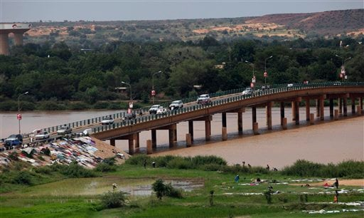 Cars cross a bridge in Niamey, Niger, Monday, Sept, 12. 2011. A convoy carrying ousted Libyan leader Moammar Gadhafi's son al-Saadi has crossed into neighboring Niger, a government spokesman for Niger's government said Sunday.