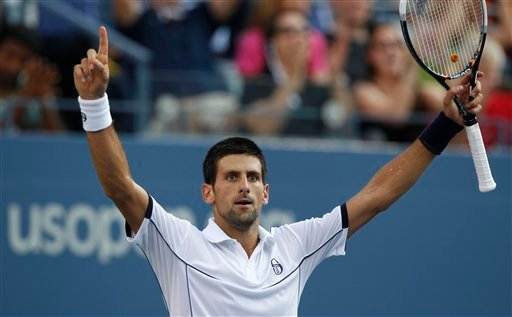 Novak Djokovic of Serbia reacts during the men's championship match against Rafael Nadal of Spain at the U.S. Open tennis tournament in New York, Monday, Sept. 12, 2011.