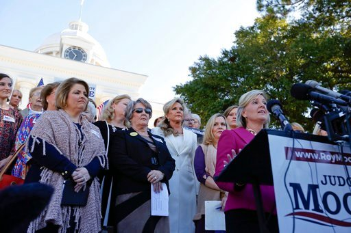 Kayla Moore, wife if former Alabama Chief Justice and U.S. Senate candidate Roy Moore, waits to speak at a news conference, Friday, Nov. 17, 2017, in Montgomery, Ala. (AP Photo/Brynn Anderson)