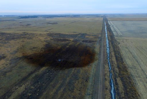 This aerial photo shows spills from TransCanada Corp.'s Keystone pipeline, Friday, Nov. 17, 2017, that leaked an estimated 210,000 gallons of oil onto agricultural land in northeastern South Dakota, near Amherst, S.D., the company and state regulators sai