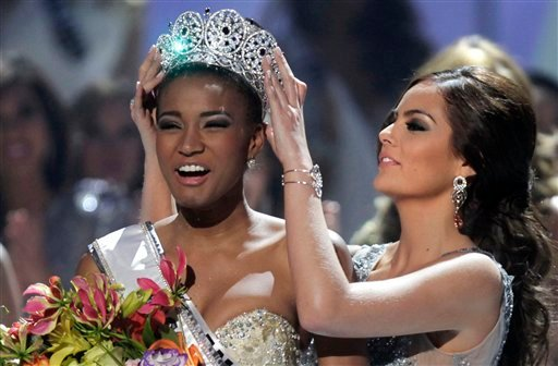 ALTERNATIVE CROP OF XAP104 - Miss Angola Leila Lopes is crowned Miss Universe 2011 by Miss Universe 2010 Ximena Navarrete, of Mexico, in Sao Paulo, Brazil, Monday Sept. 12, 2011. (AP Photo/Andre Penner)