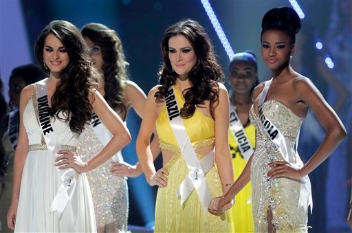 The top three finalists at the Miss Universe pageant, Miss Ukraine Olesia Stefanko, left, Miss Brazil Priscila Machado, center, and Miss Angola Leila Lopes wait for the final announcements during the pageant in Sao Paulo, Brazil, Monday, Sept. 12, 2011.