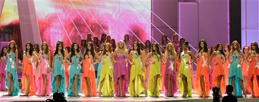 ** ADDS NAMES AND COUNTRIES ** The sixteen finalists stand in line during the Miss Universe pageant in Sao Paulo, Brazil, Monday Sept. 12, 2011.