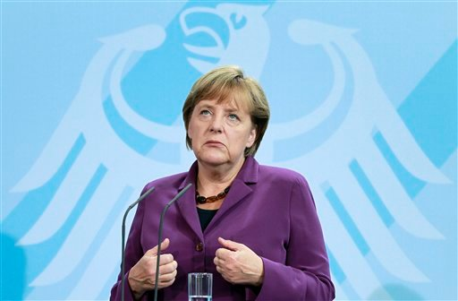 German Chancellor Angela Merkel gestures during a joint news conference with the Prime Minister of Finland, Jyrki Katainen, after a meeting at the chancellery in Berlin, Germany, Tuesday, Sept. 13, 2011. (AP)