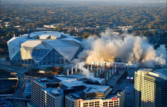 The Georgia Dome is destroyed in a scheduled implosion next to its replacement the Mercedes-Benz Stadium.