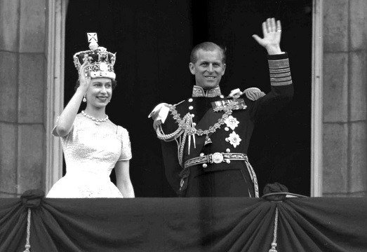 Britain's Queen Elizabeth II and Prince Philip, Duke of Edinburgh, as they wave to supporters.