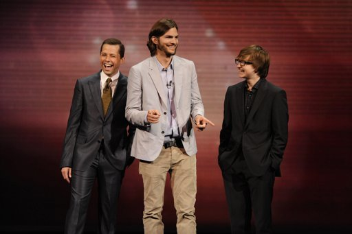"""FILE - In this May 18, 2011 file publicity image released by CBS, the cast of """"Two and a Half Men,"""" from left, Jon Cryer, Ashton Kutcher, and Angus T. Jones are shown during their presentation at CBS' Upfront at Carnegie Hall in New York."""
