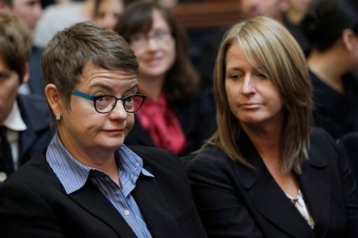 Plaintiff same sex couple Sandra Stier, right, and partner Kristin Perry, right, listen in a courtroom during a California State Supreme Court hearing in San Francisco, Monday, Sept. 6, 2011. (AP Photo/Paul Sakuma)