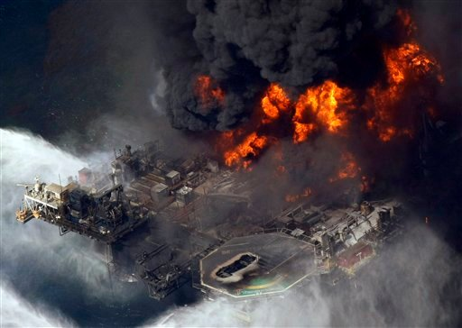 In this April 21, 2010 file photo taken in the Gulf of Mexico more than 50 miles southeast of Venice on Louisiana's tip, the Deepwater Horizon oil rig is seen burning. (AP Photo/Gerald Herbert, File)