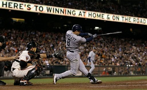 San Diego Padres' Jason Bartlett (8) hits a two-run double off of San Francisco Giants pitcher Guillermo Mota in the seventh inning of a baseball game in San Francisco, Tuesday, Sept. 13, 2011. At left is Giants catcher Eli Whiteside. (AP Photo/Jeff Chiu)