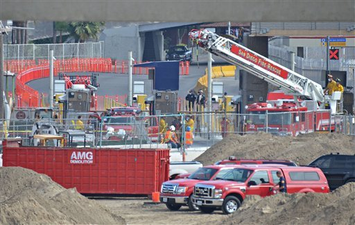 San Diego firefighters work at a construction site where a scaffolding collapsed at the San Ysidro Port of Entry in San Diego Wednesday, Sept. 14, 2011.