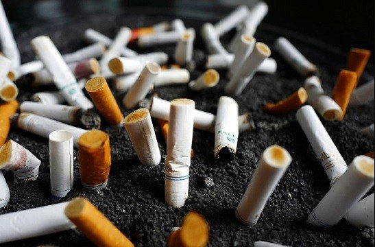 April 7, 2017, file photo, shows cigarette butts discarded in an ashtray outside a New York office building.