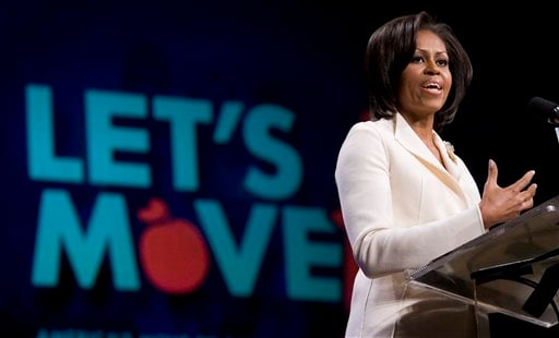 "In this Feb. 9, 2011 file photo, First Lady Michelle Obama talks about her ""Lets Move"" campaign at North Point Community Church in Alpharetta, Ga. (AP Photo/John Amis, File)"
