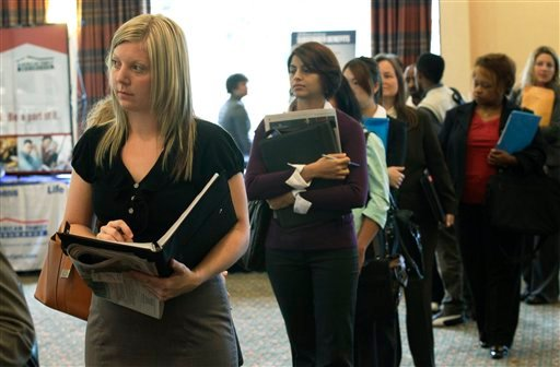 Annelie Ingvarsson, left, waits in line to talk to potential employers during a National Career Fairs job fair Sept. 14, 2011, in Bellevue, Wash. (AP Photo/Ted S. Warren)