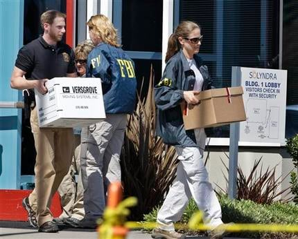 FBI agent carry dozens of boxes of evidence from Solyndra headquarters in Fremont, Calif., Thursday, Sept. 8, 2011. (AP Photo/Paul Sakuma)