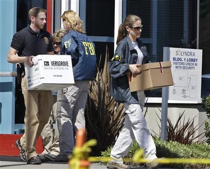 FBI agent carry dozens of boxes of evidence from Solyndra headquarters in Fremont, Calif., Thursday, Sept. 8, 2011. (AP Photo/Paul Sakuma)