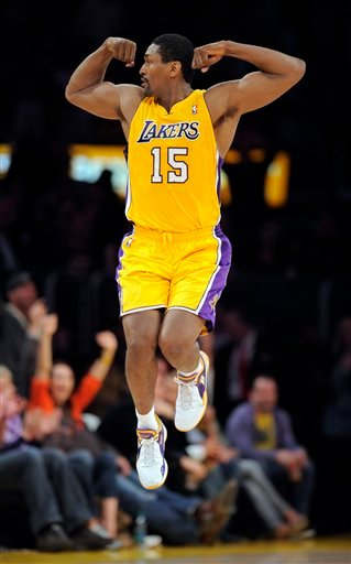 This March 25, 2011 file photo shows Los Angeles Lakers forward Ron Artest celebrating after dunking the ball during the first half of their NBA basketball game against the Los Angeles Clippers, in Los Angeles.