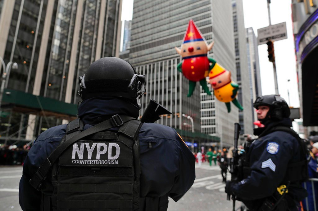 FILE - In this Nov. 24, 2016, file photo, New York Police counterterrorism personnel watch as the Macy's Thanksgiving Day parade makes its way down Sixth Avenue in New York.  (AP Photo/Julie Jacobson, File)