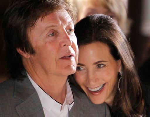 FILE - This is a Monday, Oct. 4, 2010 file photo of British musician Paul McCartney and his girlfriend Nancy Shevell as they watch Stella McCartney's spring-summer 2011 ready to wear fashion collection show in Paris.