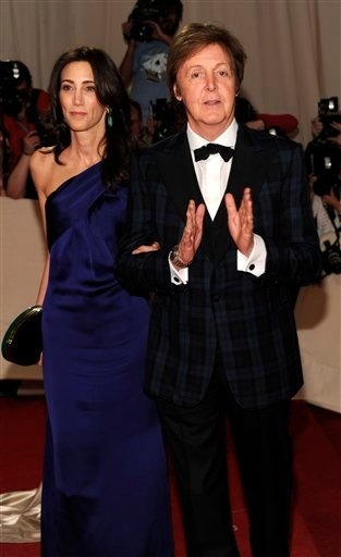FILE - In this May 2, 2011 file photo, recording artist Paul McCartney, right, and Nancy Shevell arrive at the Metropolitan Museum of Art Costume Institute gala in New York. McCartney will be honored as MusiCares person of the year during Grammy.