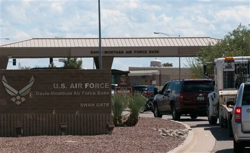 Vehicles are stopped outside an entrance to Davis-Monthan Air Force Base in Tucson, Ariz. Sept. 16, 2011, after a report of a man with a gun. (AP Photo/Gary M. Williams)
