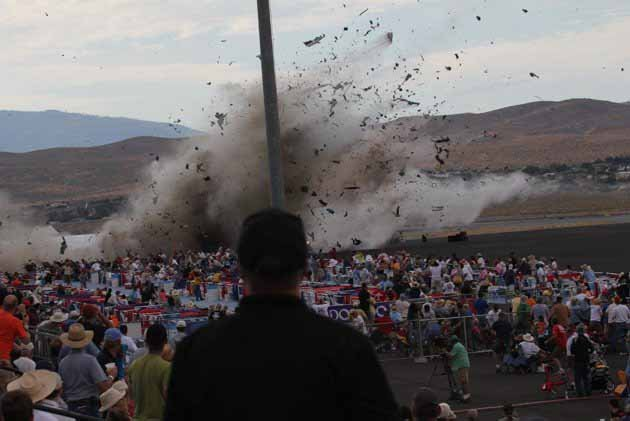 A P-51 Mustang airplane crashes into the edge of the grandstands at the Reno Air show on Friday, Sept. 16, 2011 in Reno Nevada. (AP Photo/Ward Howes)