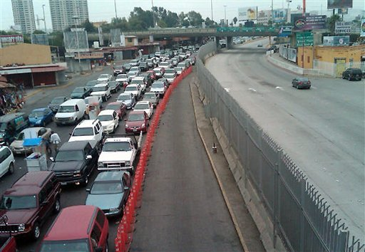 Northbound traffic heading out of Mexico into the United States is shown Thursday Sept. 15, 2011 with a section of the road, center, closed off for repairs at the San Ysidro Port of Entry in San Ysidro, Calif.