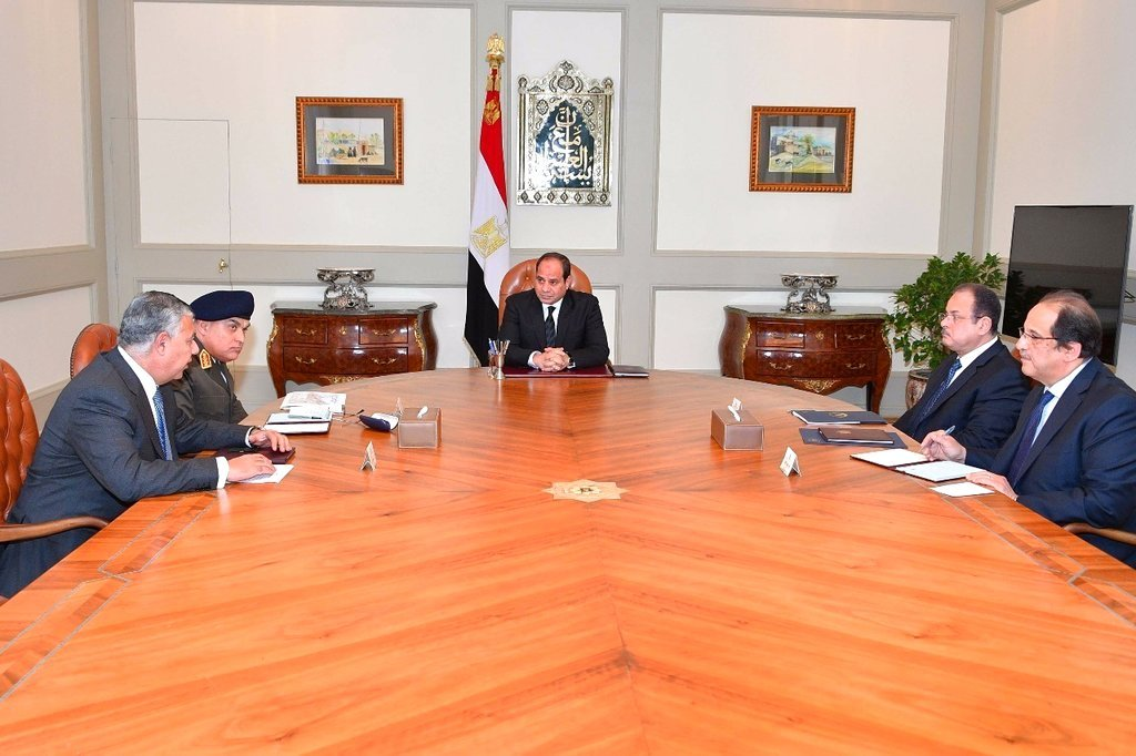 Photo released by Egypt's Presidency shows Abdel-Fattah El-Sissi, center, meeting with officials in Cairo after militants attacked a crowded mosque during Friday prayers in the Sinai Peninsula.  (Egyptian Presidency via AP)