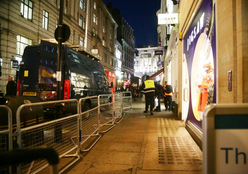 The scene outside the London Palladium in the west end of London after Oxford Circus station was evacuated Friday Nov. 24, 2017. (Yui Mok/PA via AP)