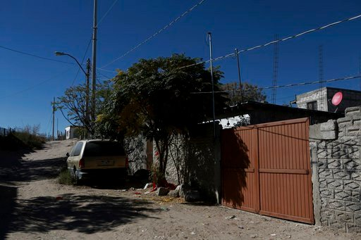 The gate stands closed at the home where three girls were attacked in a low-income neighborhood of Ciudad Juarez, Mexico, Friday, Nov. 26, 2017.(AP Photo/Christian Torres)