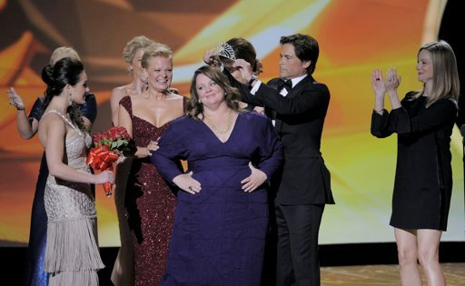 """Rob Lowe, crowns Melissa McCarthy as Sofia Vergara, second right, gives her the award for outstanding lead actress in a comedy series for """"Mike and Molly"""" at the 63rd Primetime Emmy Awards on Sunday, Sept. 18, 2011 in Los Angeles."""