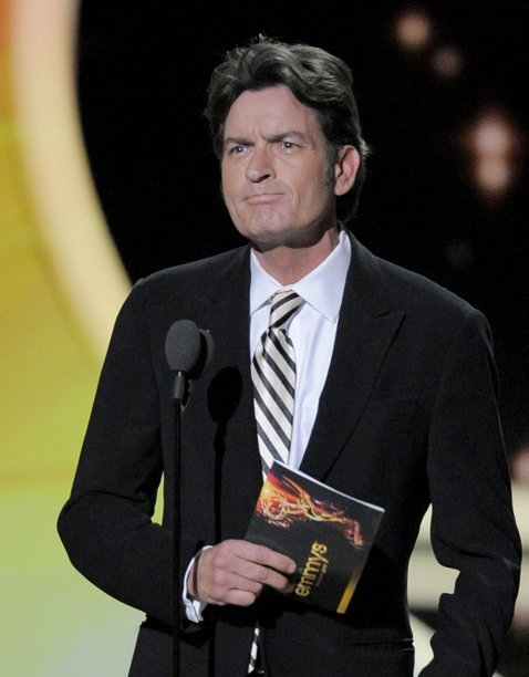Charlie Sheen presents the award for outstanding lead actor in a comedy series at the 63rd Primetime Emmy Awards on Sunday, Sept. 18, 2011 in Los Angeles. (AP Photo/Mark J. Terrill)