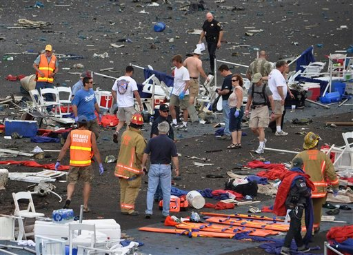 In this Sept. 16, 2011 file photo, a crowd gathers around debris after a P-51 Mustang airplane crased at the Reno Air show in Reno Nev. (AP Photo/Grass Valley Union, Tim O'Brien, File)