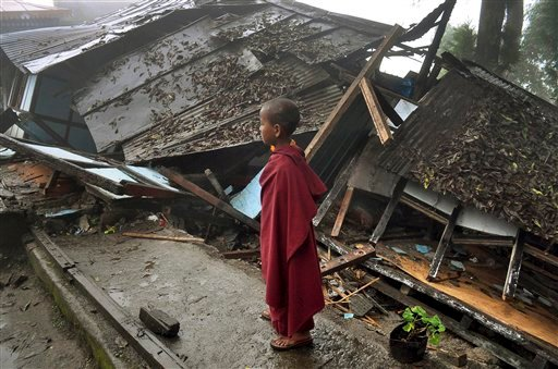 A young Buddhist monk looks on at a monastery damaged by Sunday's earthquake in Gangtok, India, Monday, Sept. 19, 2011. (AP Photo)
